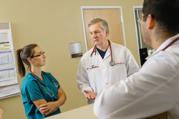 Resident learning with faculty physician.