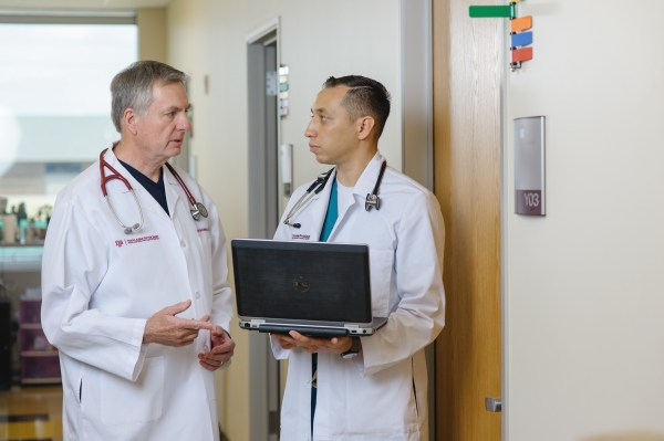 Graduate medical student learns from faculty physician