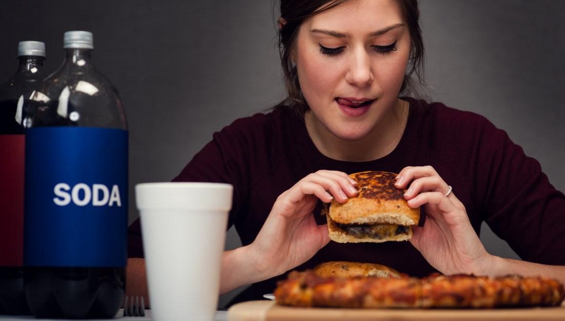 girl eating burger