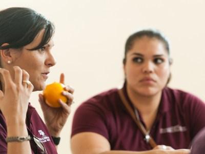 Student with orange