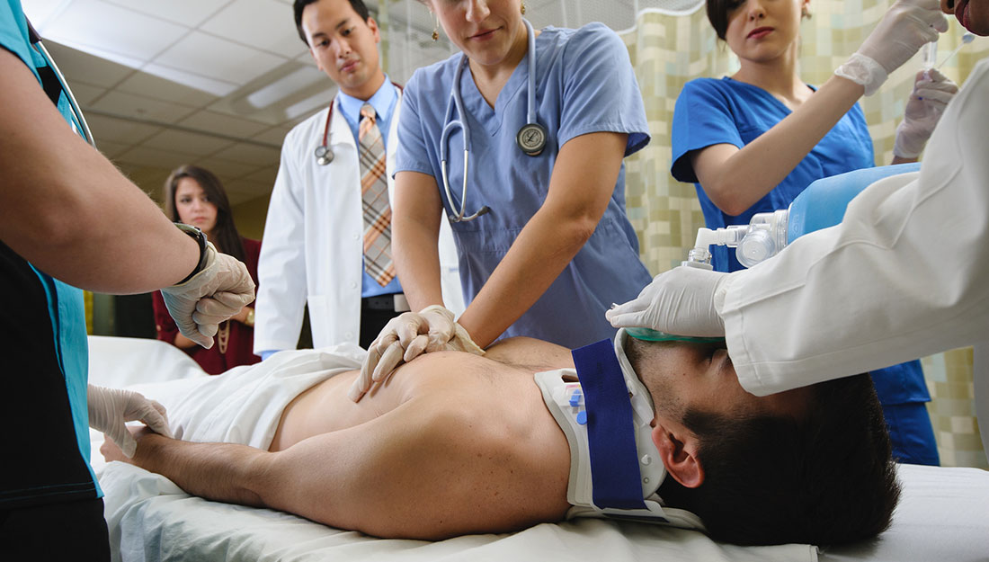 Different health professionals working on patient