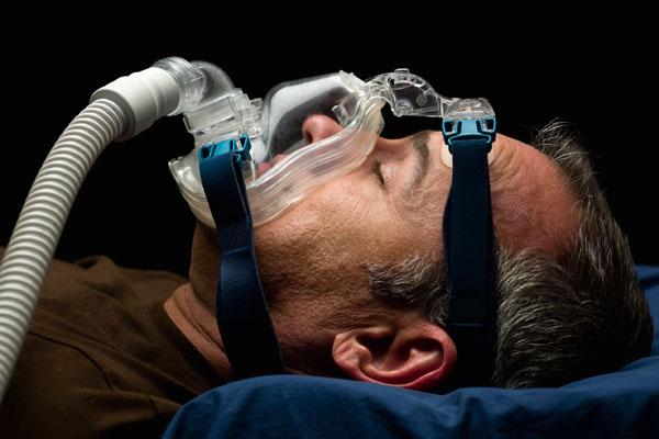 man in snoring mask