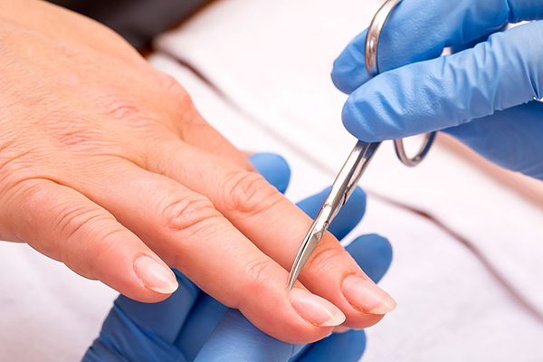 health risks at nail salons - cuticle cutting leads to nail fold infections