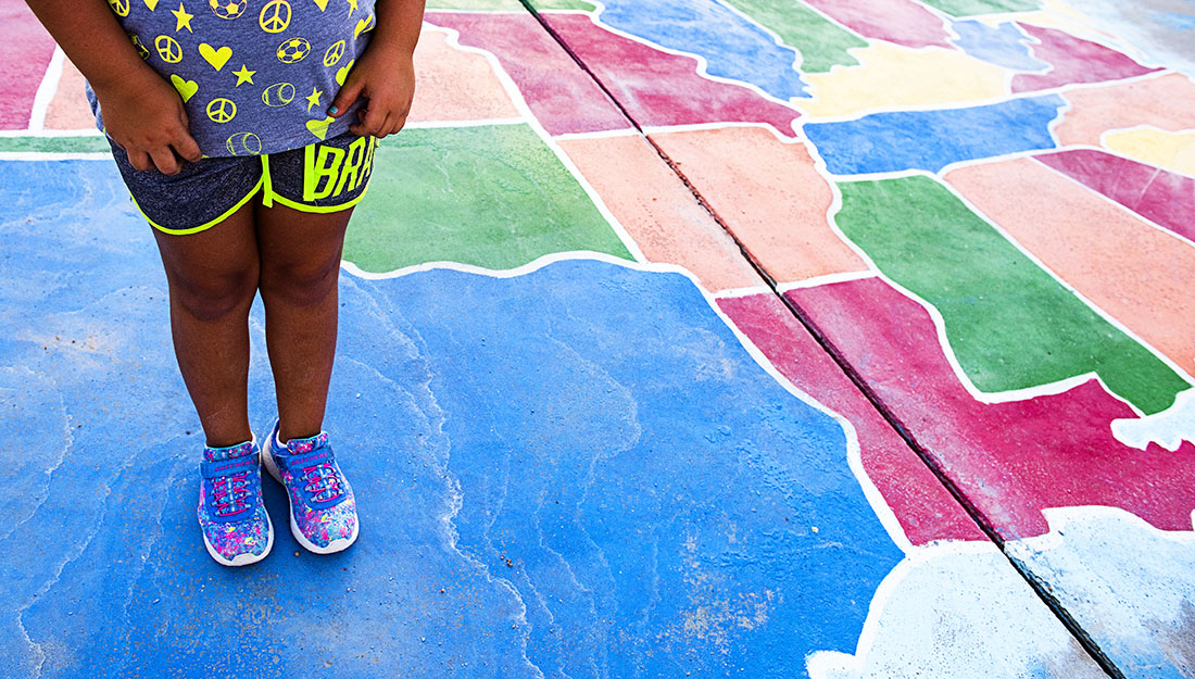 child standing on Texas on map of US