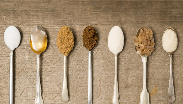 spoonfuls of different types of sugars or sweeteners