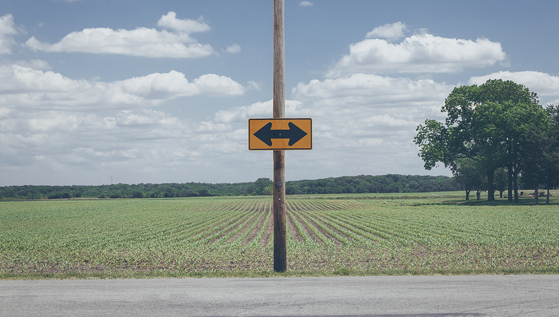 Arrow sign on a rural road
