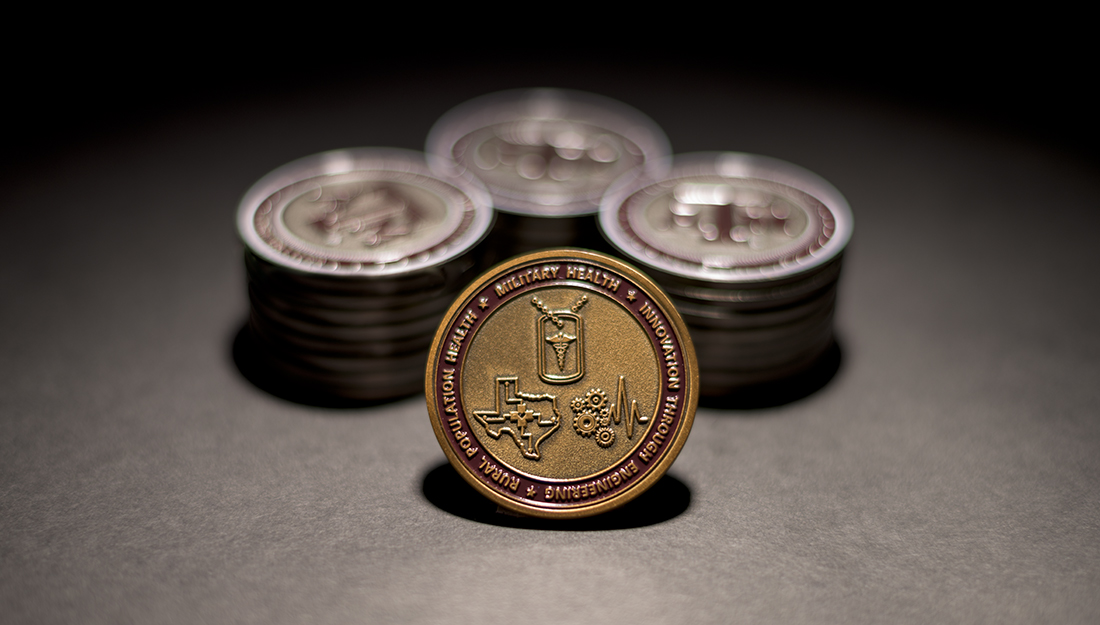 Stacks of challenge coins - gifts to Texas A&M University Health Science Center