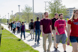 Students and faculty walk around their building to manage stress