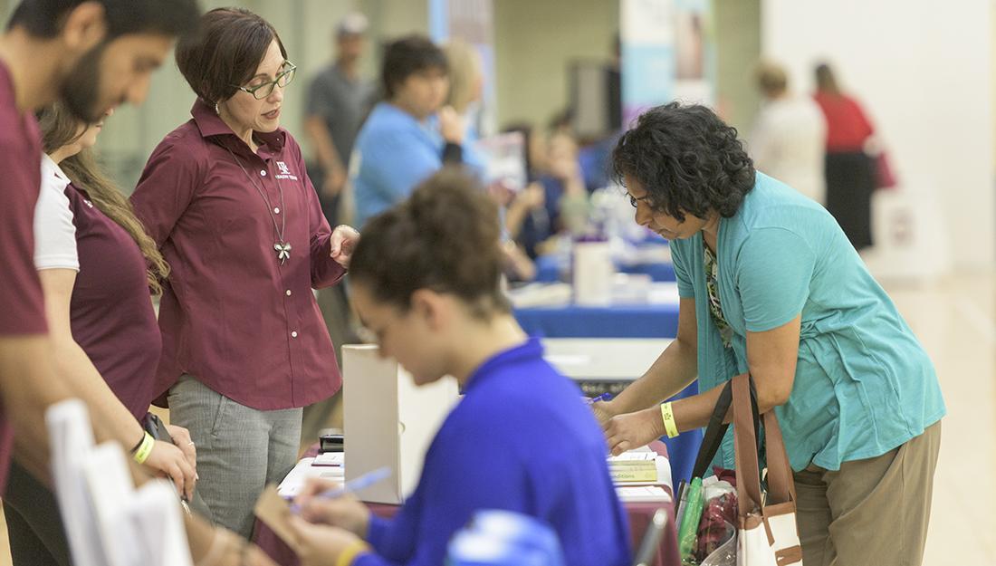 Participants receive health screenings at a health fair.