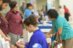 Participants receive health screenings at a health fair.