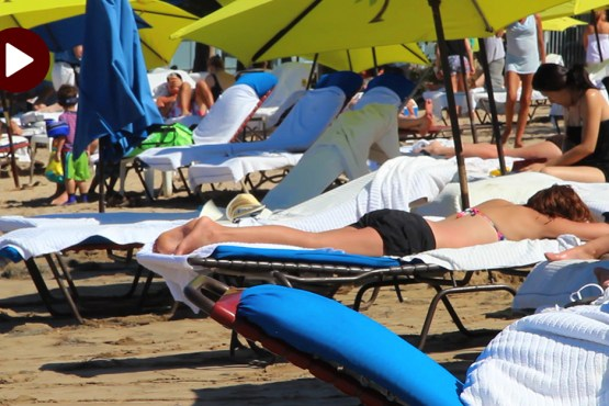 How to use sunscreen properly - an image of sunbathers on a beach