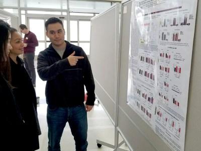 Alex Tseng presenting a poster