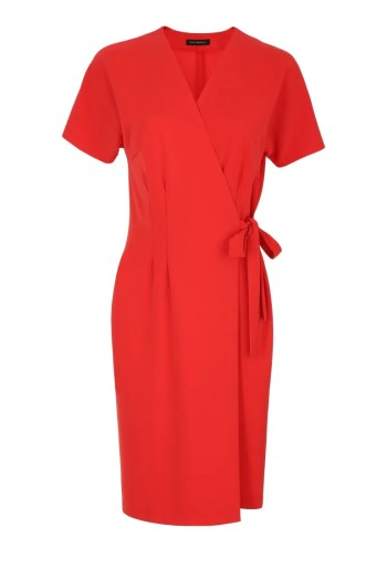 Klasyczna, kopertowa pomarańczowa sukienka marki Vito Vergelis