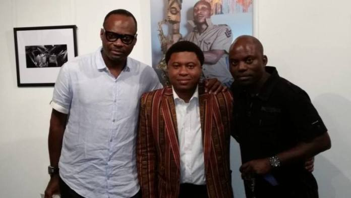 Industry giants Mr Ayo Shonaiya (new owner of the KWAM1 piece) and Timi Adegbite supporting the man of the hour