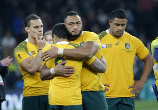 Australia players react after the Rugby World Cup final (AP Photo/Christophe Ena)