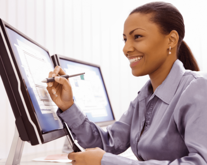 Black-Businesswoman-with-Computer-and-Cell-Phone