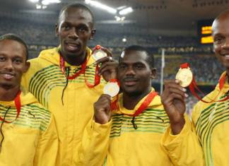 Gold medalists Jamaica's men's 4 x 100 relay team pose during the medal ceremony of of the athletics competition in the National Stadium at the Beijing 2008 Olympic Games