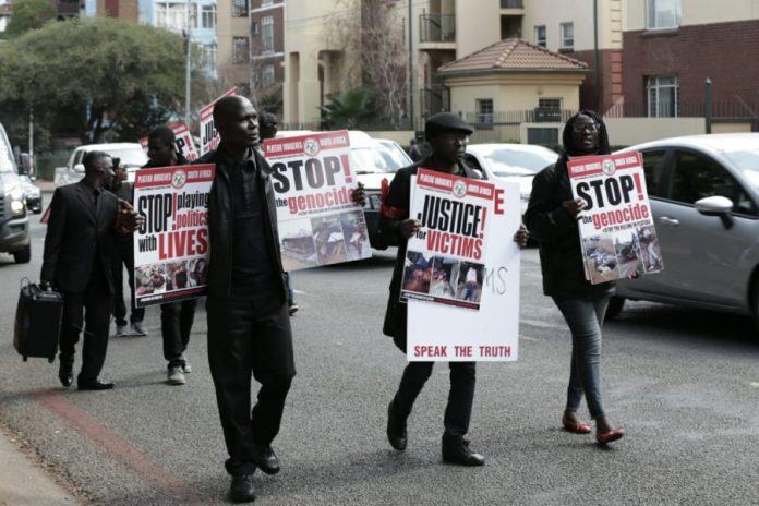 Protest March by Nigerians In South Africa against the Plateau Killings -1