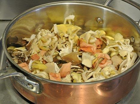mushrooms sautéing in copper pan