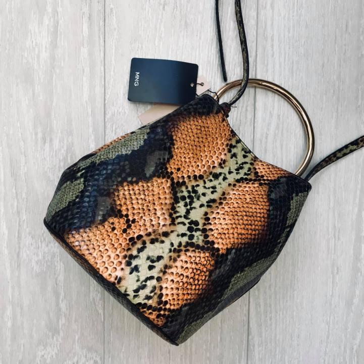 gold handle bag with snake skin print