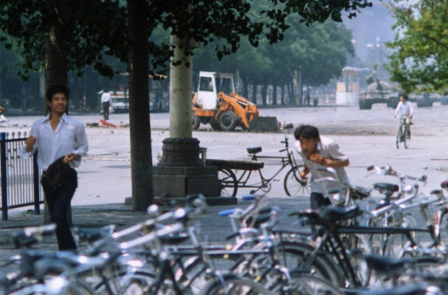 "A different angle taken of ""Tank Man,"" the man who stood against a line of tanks in Tiananmen Square. He is standing in the stre"