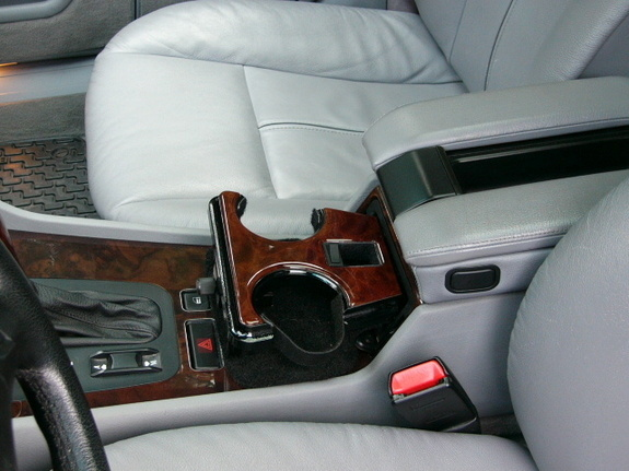 Driver's cup holder is for the right hand