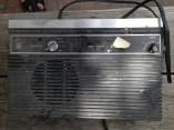 Ancient clock radio. TRASH.