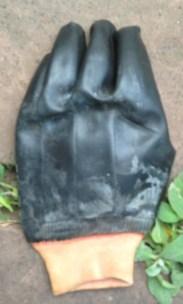One chemical glove. TRASH.