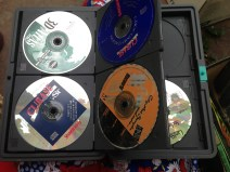 12 defunct computer game discs. TRASH.