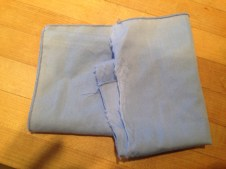 This napkin came out of the wash torn in half. Where is the other half? TRASH.