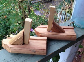 A craft project that has slowly made the migration from the table, to the counter top, to next to the door, and now on the porch. They are going to make the final push to the trash.