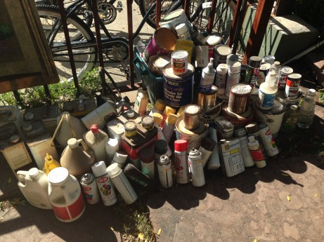 77 cans of old paint thinner, varnish, lighter fluid, oil, fuel preservative and more.