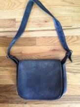 Coach bag Lonny got at an estate sale. I like backpacks. eBay.