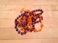 Margi Gras beads. I swear these things reproduce like earthworms. TRASH.