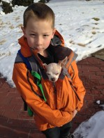 Testiclese walking Chicky home from school. He was cold.
