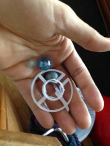 Metal balls, marble, plastic thing