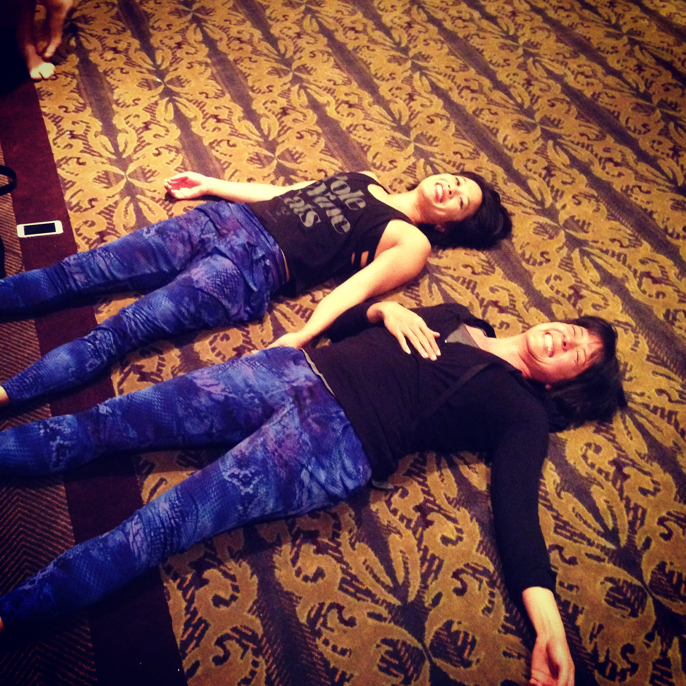 """Me wearing the same pants as Natasha and interrupting her chiro session to take a picture. """"Twins!"""""""