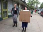 Natasha carries her own boxes