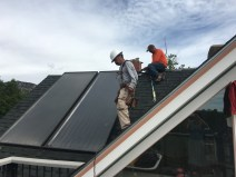 The solar panels are coming down and the roof is getting patched