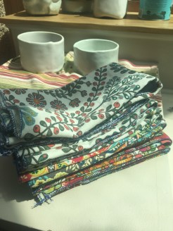 Turned tablecloth scraps into napkins using the rolled edge feature