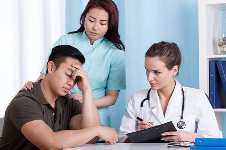30662678-sad-patient-during-medical-appointment-in-the-office