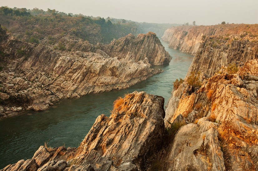 Narmada river cuts through Bhedaghat marble rocks