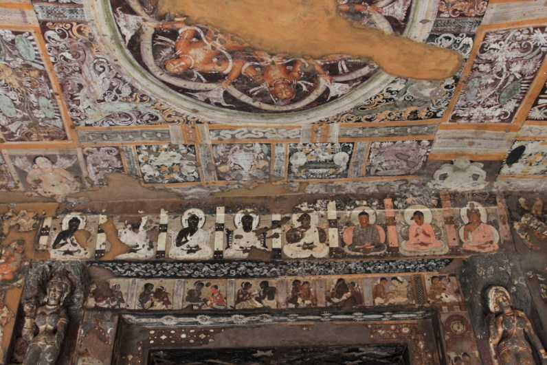 Murals showing Buddha in various mudras