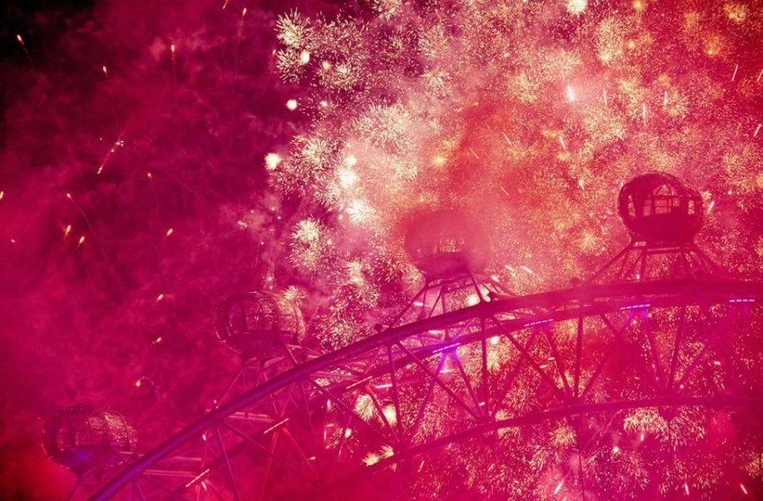 Fireworks light up the London Eye during the New Year celebrations in central London just after midnight on January 1, 2013.