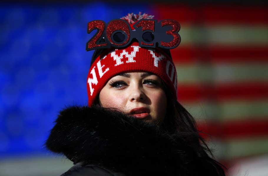 A reveler stands in Time Square before celebrating the New Year in New York City, on December 31, 2012.