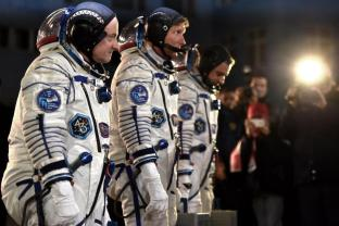 From L: US astronaut Scott Kelly and Russian cosmonauts Gennady Padalka and Mikhail Kornienko walk after their space suits were tested at the Russian-leased Baikonur cosmodrome late on March 27, 2015. The international crew is scheduled to blast off to the ISS from Baikonur early on March 28, Kazakh time. AFP PHOTO / KIRILL KUDRYAVTSEVKIRILL KUDRYAVTSEV/AFP/Getty Images