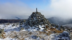The summit cairn with distinctly less snow than last year!