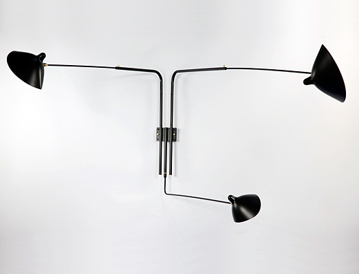 MSC-R3: this sconce can project light into a room at varying angles due to the independent rotation of each arm and each shade.