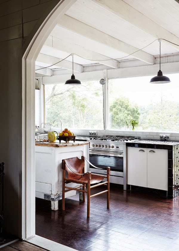 What a great chair in this old converted church kitchen in Australia - via Cococozy