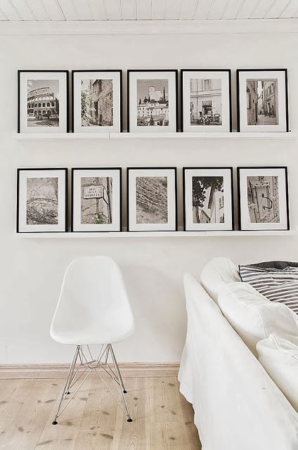 Black & white interiors theme extended into the pictures and frames - via Cococozy